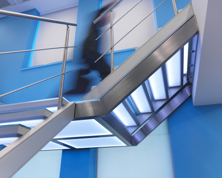 Illuminated stairs with glass treads in the offices of Mainsys